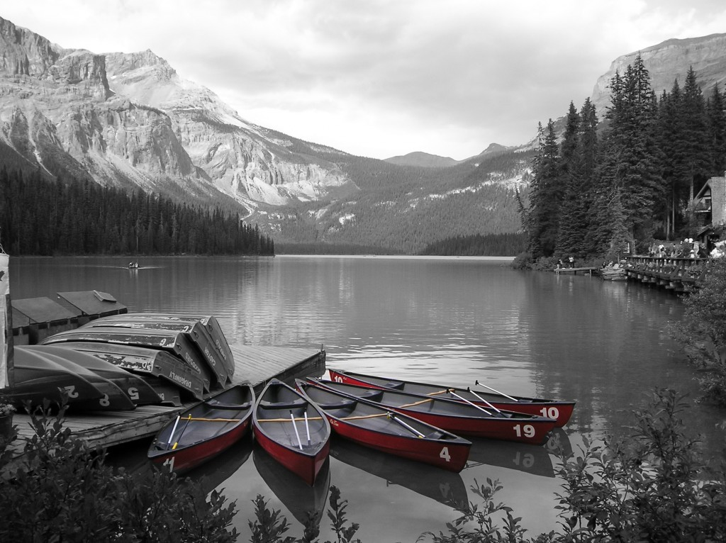 Selective color photograph of red boats.