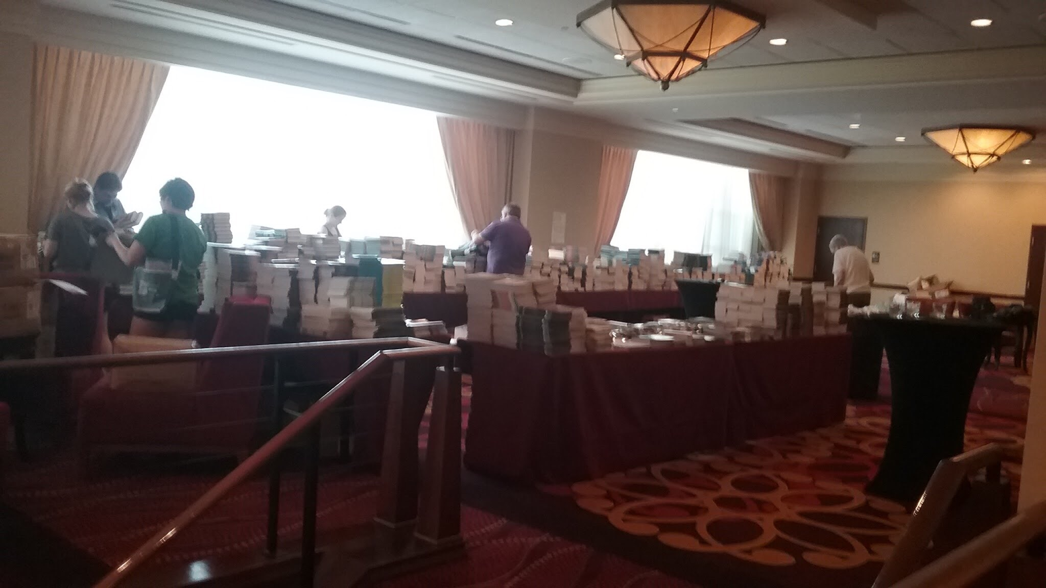 Tables piled high with books