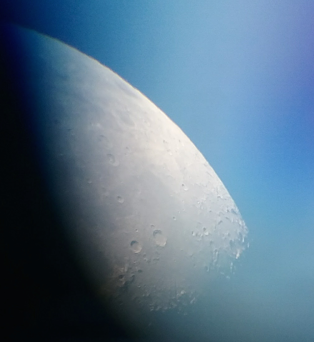 Moon picture taken with phone through a telescope lens.