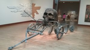 skull and wagon art installation