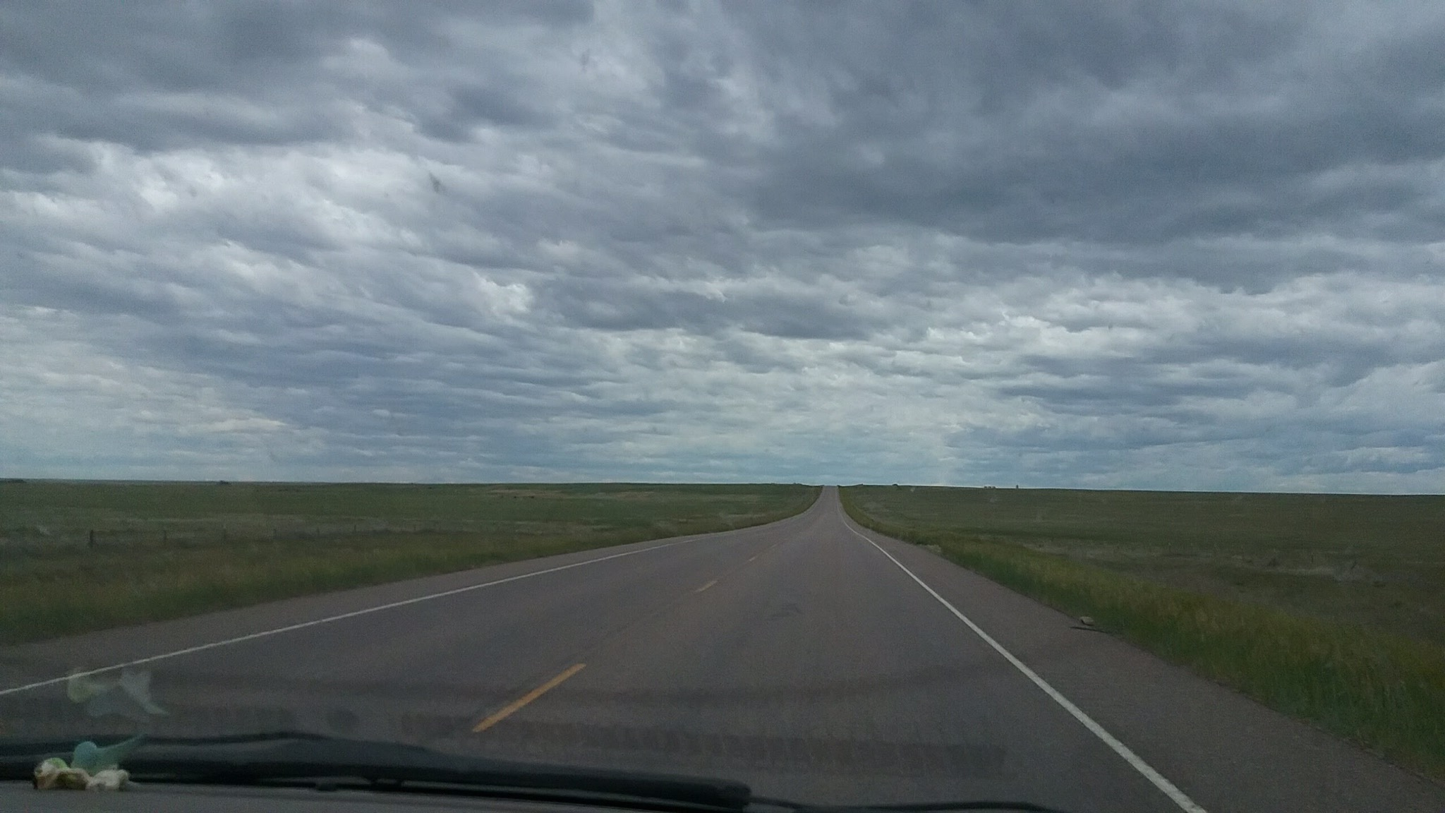 cloudy skies over flat land