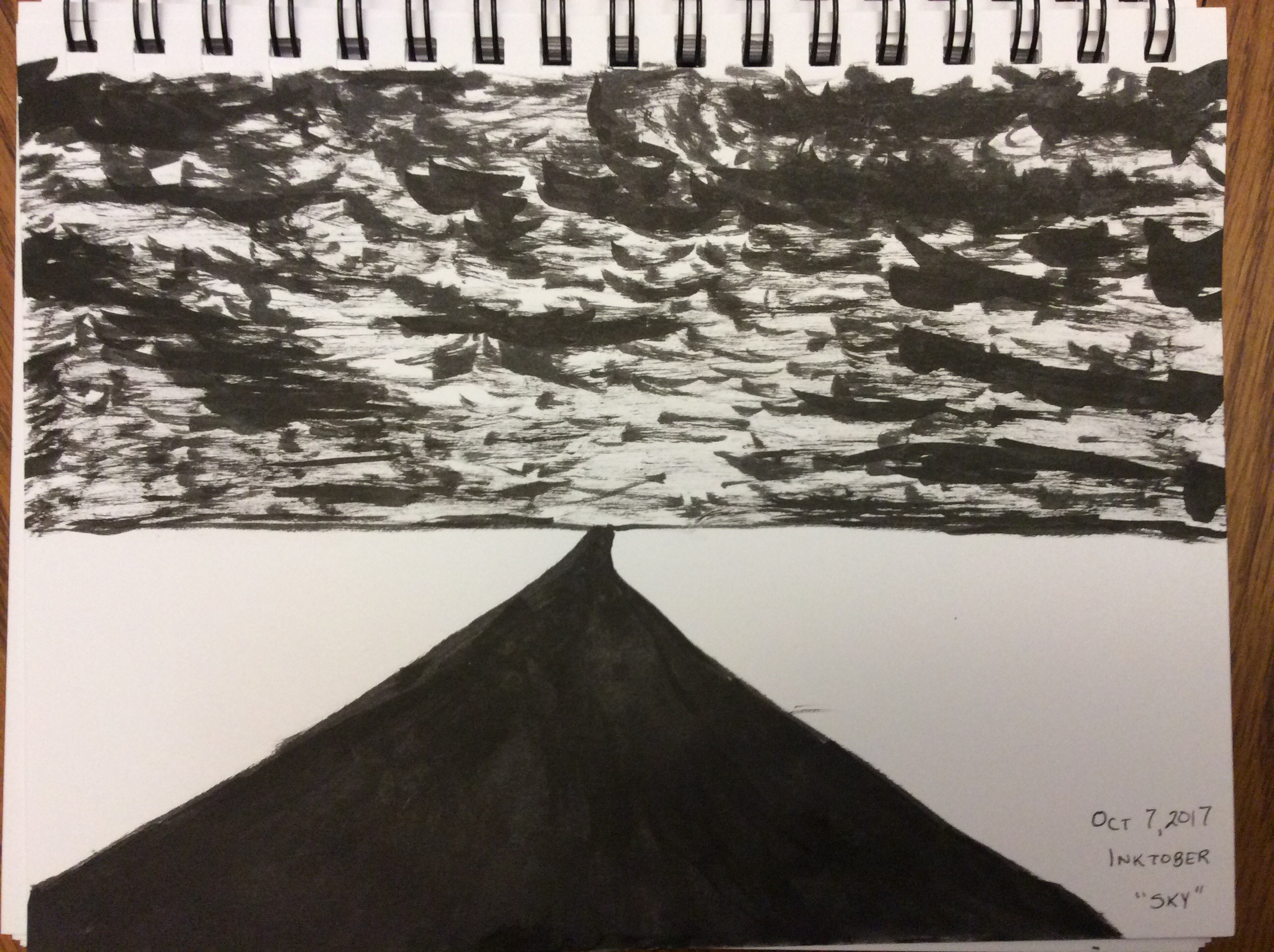 ink drawing of cloudy sky over flat landscape